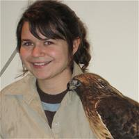 Naturalist Miranda holding Red Tailed Hawk